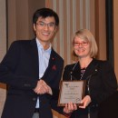 Zhao Zhang receives the 2015 Larry Sandler Memorial Award from Erika Bach