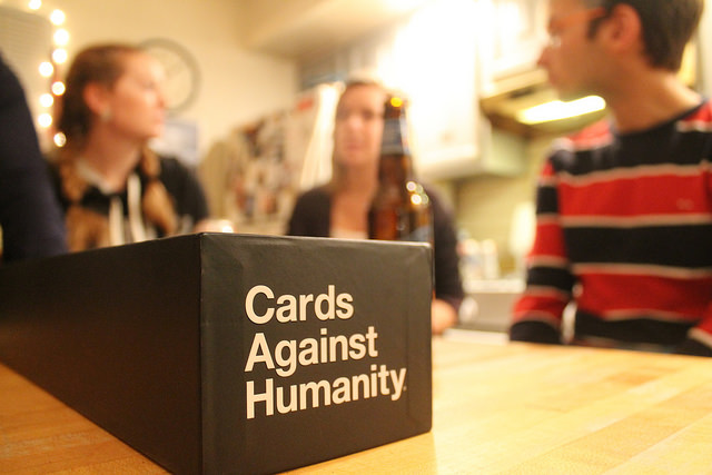 Playing Cards Against Humanity.
