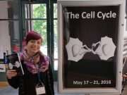 Cover and abstract book at the Cell Cycle Meeting in Cold Spring Harbor. In the final step of cell division, the bridge connecting the cells is cut to give rise to two separate daughter cells.