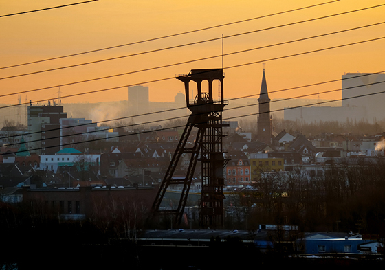 """Sunrise over the city of Bochum, in the foreground the winding tower of the former mine """"Holland"""" (all mines were named, e.g. after people, places, organizations)."""