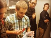 Photo of University of Pennsylvania graduate student giving undergraduate students a lab tour.