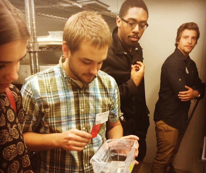 Photo of University of Pennsylvania graduate student giving undergraduate students a lab tour.