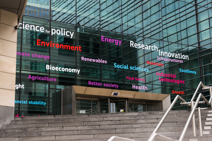 Photo of building with words related to how science helps policy