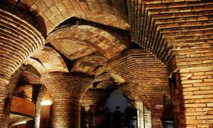 Image: Photograph of supportive brick arches in the basement of the Palau Güell by V C via Flickr, CC BY-NC 2.0 license.