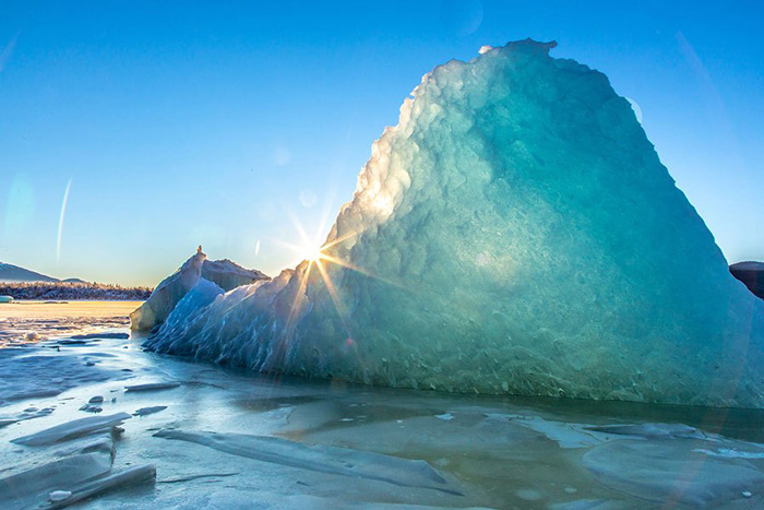 Photo of iceberg in the sun.