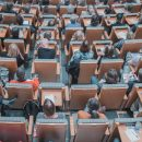 Photo of conference attendees sitting in an auditorium.
